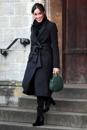 CARDIFF, WALES - JANUARY 18: Meghan Markle departs from a walkabout at Cardiff Castle on January 18, 2018 in Cardiff, Wales. (Photo by Karwai Tang/Karwai Tang/WireImage)