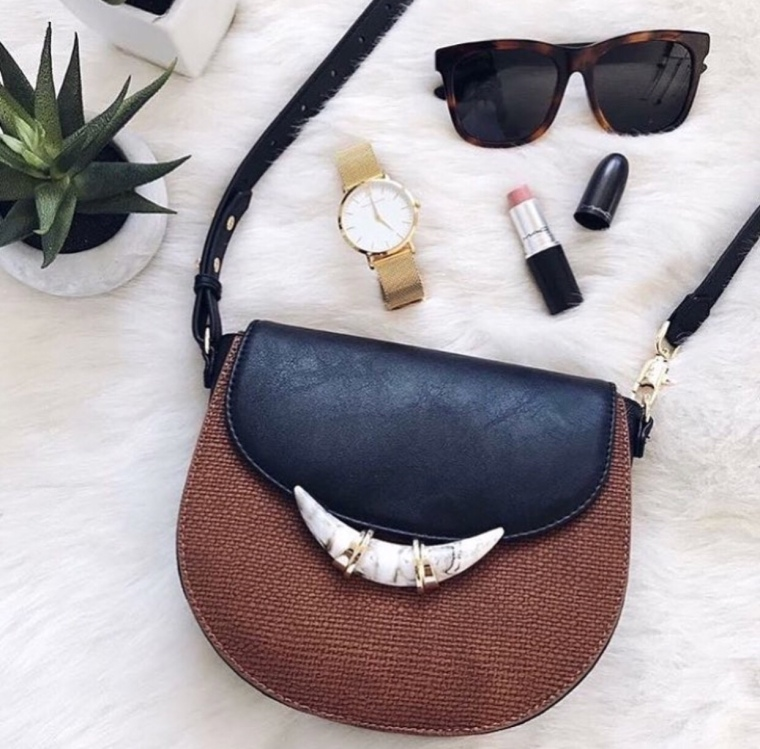 Summer 2018 Women's Fashion Saddle Bag in two tone leather with a marbled horn pendant and a vegan leather cross body strap